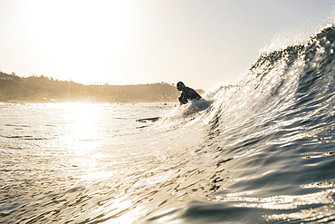 Caucasian man surfing