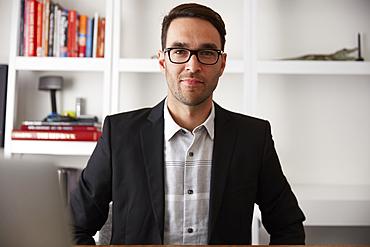 Portrait of smiling Caucasian businessman in office