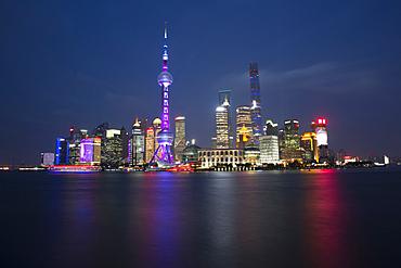 Illuminated city waterfront, Beijing, China