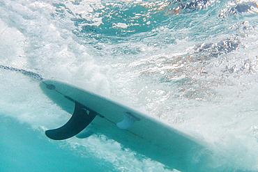 Underwater view of surfboard