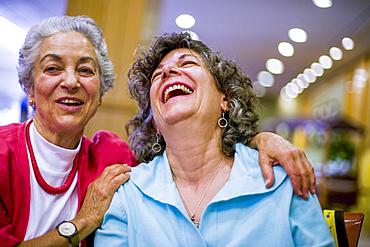 Caucasian women laughing