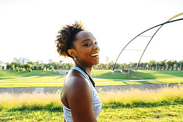 Portrait of smiling mixed race woman in park