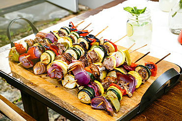 Meat and vegetables on skewers
