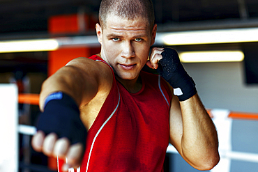Portrait of Caucasian boxer punching