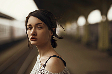 Portrait of serious Caucasian woman at train station