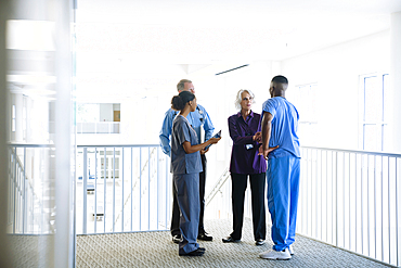 Doctors and nurses talking near staircase