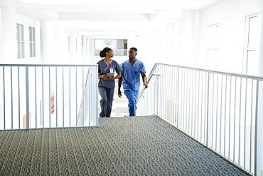 Nurses climbing staircase