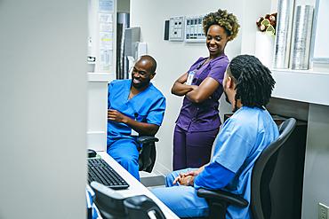 Nurses laughing in hospital