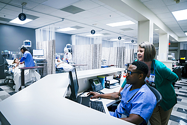 Doctor and nurse using computer in hospital