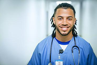 Portrait of smiling mixed race nurse