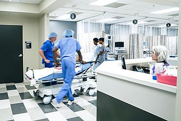 Nurses pushing hospital gurney