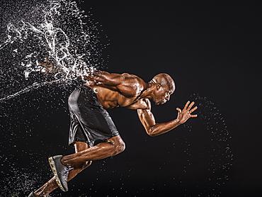 Water splashing on black runner