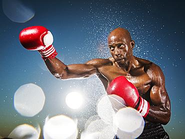 Water splashing on black boxer outdoors