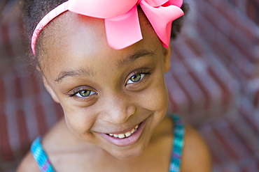Close up of smiling mixed race girl