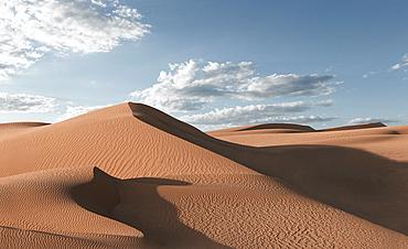 Shadows on sand dunes in desert