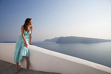 Caucasian woman admiring scenic view of ocean