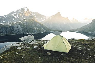 Camping tent near mountain lake