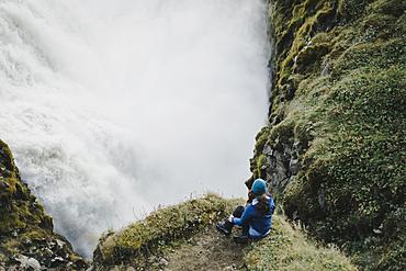 Caucasian woman watching waterfall
