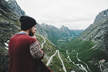 Caucasian man admiring scenic view of valley