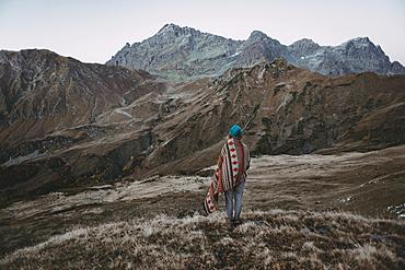 Caucasian woman standing in remote mountain landscape
