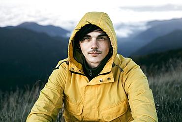 Portrait of Caucasian man in remote mountain landscape