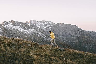 Caucasian man hiking in remote mountain landscape