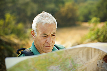 Caucasian man reading map