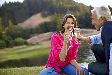 Couple toasting with wine and laughing