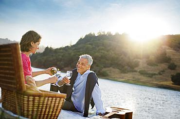 Couple enjoying wine at waterfront