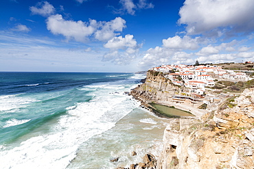 Top view of the perched village of Azenhas do Mar surrounded by the crashing waves of the Atlantic Ocean, Sintra, Portugal, Europe