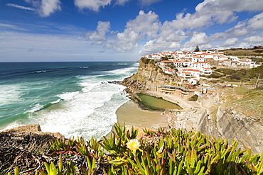 Top view of the perched village of Azenhas do Mar surrounded by the Atlantic Ocean and green vegetation, Sintra, Portugal, Europe