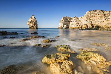 Ocean waves and cliffs at sunrise, Praia da Marinha, Caramujeira, Lagoa Municipality, Algarve, Portugal, Europe