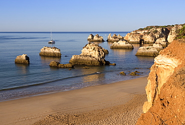 View of the fine sandy beach bathed by the blue ocean at dawn, Praia do Alemao, Portimao, Faro district, Algarve, Portugal, Europe