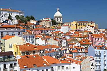 Terracotta roofs and the ancient dome seen from Miradouro Alfama one of the many viewpoints of Lisbon, Portugal, Europe