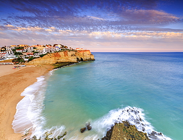 Panoramic view of Carvoeiro village surrounded by sandy beach and clear sea at sunset, Lagoa Municipality, Algarve, Portugal, Europe