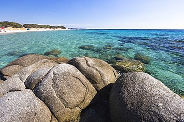 Rocks frame the turquoise water of sea around the sandy beach of Sant Elmo Castiadas, Costa Rei, Cagliari, Sardinia, Italy, Mediterranean, Europe