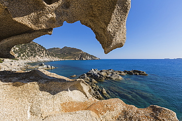 View of the blue sea from a natural sea cave of rocks shaped by wind, Punta Molentis, Villasimius, Cagliari, Sardinia, Italy, Mediterranean, Europe