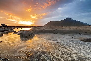 The midnight sun reflected on the sandy beach of Skagsanden, Ramberg, Nordland county, Lofoten Islands, Arctic, Northern Norway, Scandinavia, Europe