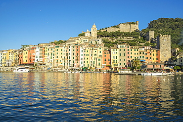 The blue sea frames the typical colored houses of Portovenere, UNESCO World Heritage Site, La Spezia Province, Liguria, Italy, Europe