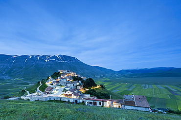 Dusk on the medieval village surrounded by green fields, Castelluccio di Norcia, Province of Perugia, Umbria, Italy, Europe
