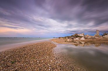 Storm clouds are reflected in the clear water at sunset, Porto Recanati, Province of Macerata, Conero Riviera, Marche, Italy, Europe