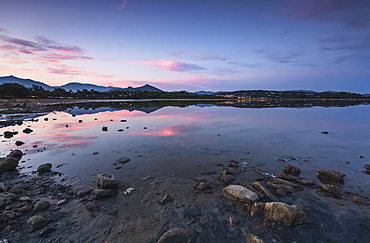 Pink clouds at sunset are reflected in the blue sea, Villasimius, Province of Cagliari, Sardinia, Italy, Mediterranean, Europe