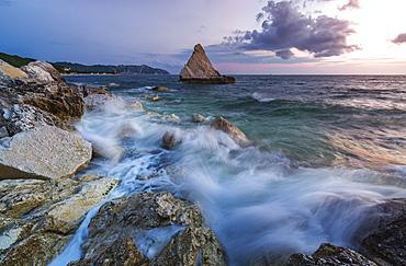 Waves of blue sea framed by the pink sunrise, La Vela Beach, Portonovo, province of Ancona, Conero Riviera, Marche, Italy, Europe