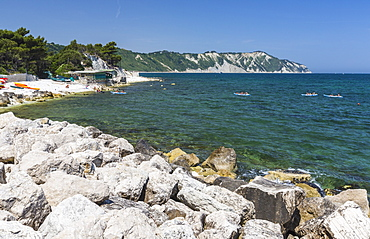 Canoe in the bay surrounded by the turquoise sea, Province of Ancona, Conero Riviera, Marche, Italy, Europe