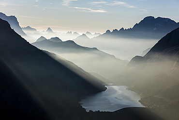 Mist on peaks of Dolomites and Monte Civetta seen from Cima Belvedere at dawn, Val di Fassa, Trentino-Alto Adige, Italy, Europe