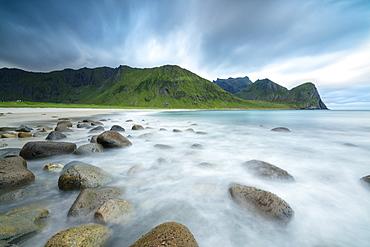The midnight sun lights up the waves of the blue sea, Unstad, Vestvagoy, Lofoten Islands, Arctic, Norway, Scandinavia, Europe