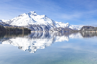 Snowy peaks reflected in the clear water of Lake Sils, Maloja, Canton of Graubunden, Engadine, Switzerland, Europe