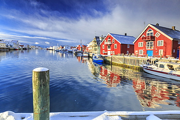 View of colorful fishermen's houses and private boats overlooking the canal-port of Henningsvaer, Lofoten Islands, Arctic, Norway, Scandinavia, Europe