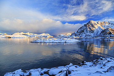 The feeble light of the sunset on a fjord near Henningsvaer covered in snow, Lofoten Islands, Arctic, Norway, Scandinavia, Europe