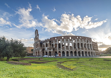 Blue sky at sunrise frames the ancient Colosseum (Flavian Amphitheatre), UNESCO World Heritage Site, Rome, Lazio, Italy, Europe